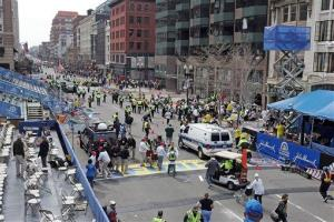 People react to an explosion at the 2013 Boston Marathon in Boston, Monday, April 15, 2013. Warning: Next image is graphic.