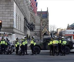 Boston police officers keep a perimeter secure in Boston's Copley Square, April 16, 2013 as an investigation continues into the bomb blasts that killed 3 and injured over 140 people.