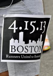 A member of the Wilmington Roadrunners, a group that meets weekly to run in downtown Wilmington, N.C.,wears a special pennant on Tuesday.