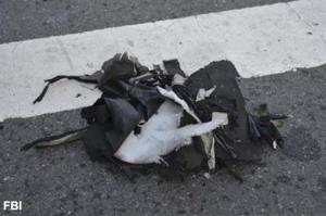 This image from a joint bulletin issued to law enforcement  shows the remains of a black backpack  that the FBI says held one of the bombs.