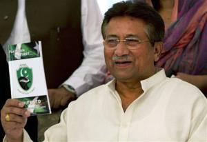 In this Monday, April 15, 2013 photo, Pakistan's former President and military ruler Pervez Musharraf shows his party's  manifesto leaflet in Islamabad, Pakistan.