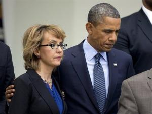 President Barack Obama, right, puts his arm around former Rep. Gabrielle Giffords, D-Ariz.
