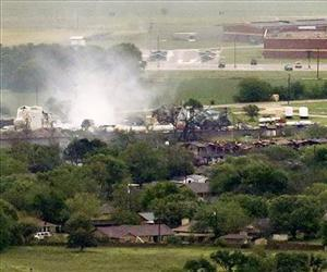 This aerial photo shows a local school, at rear, and an apartment complex, at middle right, near a fertilizer plant explosion site, April 18, 2013, in Near West, Texas.