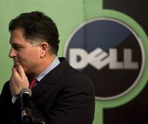 In this Thursday, March 26, 2009 file photo, Michael Dell, Chairman and CEO of Dell Inc., reacts to a question during a news conference in Beijing.