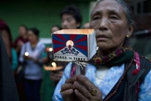 An exile Tibetan participates in a candlelit vigil in Dharmsala, India, Wednesday, April 17, 2013.