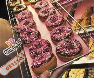 In this Feb. 12, 2008 file photo a rack of donuts is displayed at a Dunkin' Donuts franchise in Boston.