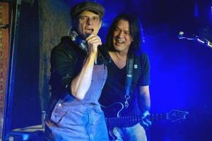Van Halen members Eddie Van Halen, right, and David Lee Roth perform at Cafe Wha? in New York, Thursday, Jan. 5, 2012.