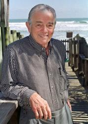 Al Neuharth, founder of USA Today, poses at his home in Cocoa Beach, Fla., in 1999.