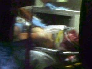 This still frame from video shows Boston Marathon bombing suspect Dzhokhar Tsarnaev visible through an ambulance.