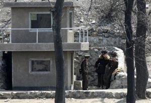 In this Monday, April 15, 2013 photo, North Korean soldiers stand outside their watch house on the river bank of the North Korean town of Sinuiju, opposite the Chinese border city of Dandong.
