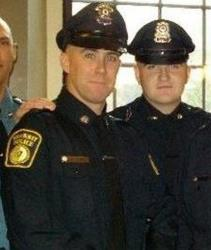 Richard Donohue Jr., left, and Sean Collier pose together for a photo at their 2010 graduation from the Municipal Police Officers' Academy. Collier was fatally shot at MIT Thursday night.