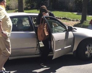 In this Sunday, April 21, 2013 photo, Katherine Russell, center, exits a car at the home of her parents in Rhode Island.