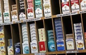 Cigarette packs are displayed at a convenience store in New York, Monday, March 18, 2013.