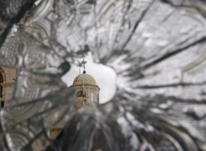A church dome is seen through a convent window damaged by artillery fire in Syria.
