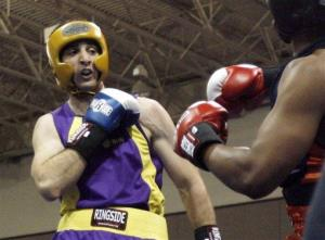 In this May 4, 2009  photo,  Tamerlan Tsarnaev, left, fights Lamar Fenner of Chicago during the 2009 Golden Gloves National Boxing Tournament.