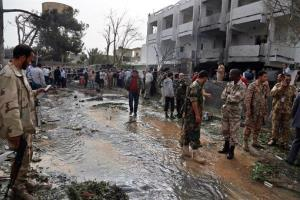 Security personnel inspect the site of a car bomb that targeted the French embassy, wounding two French guards and causing extensive damage.