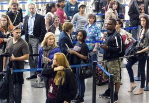 Travelers stand in line at Los Angeles International airport in Los Angeles Monday, April 22, 2013.
