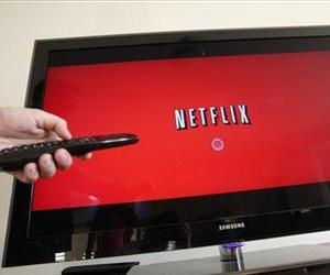 This July 20, 2010 file photo shows a Netflix customer turns on Netflix in Palo Alto, Calif.