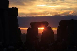 The sun is rising behind the Stonehenge monument in England, during the summer solstice shortly after 04:52am, Monday, June 21, 2010.