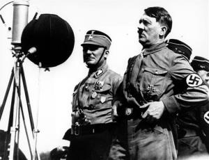 This May 7, 1933, photo shows German chancellor Adolf Hitler speaking to 30,000 uniformed Nazi storm troopers at Kiel, Germany.
