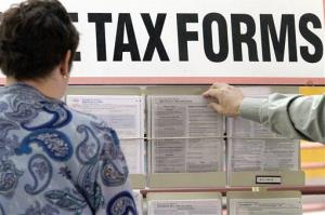 Taxpayers search through tax forms at the Illinois Department of Revenue in Springfield in this file photo.
