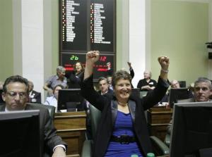 Rhode Island state Sen. Donna Nesselbush, D-Pawtucket,  reacts after the gay-marriage bill passed.