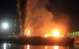 Fire burns aboard two fuel barges along Mobile River after explosions sent three workers to the hospital Wednesday April 24, 2013.