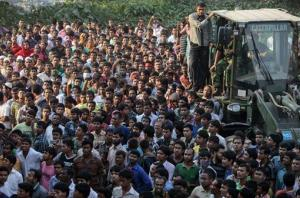 A crowd gathers to watch rescue work at the site of a building that collapsed in Savar, near Dhaka, Bangladesh, Wednesday, April 24, 2013.