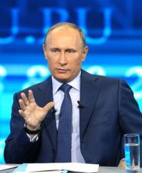 Russian President Vladimir Putin speaks during an annual call-in show on Russian television, Conversation With Vladimir Putin,  in Moscow earlier today.