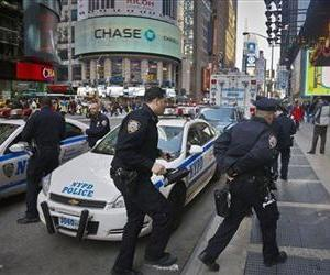 Police monitor New York's Times Square during an increase in security following an explosion at the finish line of the 2013 Boston Marathon on Monday, April 15, 2013.