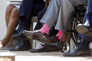 Former President George H.W. Bush wears pink socks at the library dedication in Dallas.