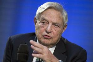 George Soros speaks in Berlin last year.