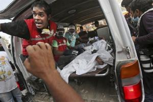 A Bangladeshi worker who was pulled alive from the rubble lies in an ambulance Friday, April 26, 2013.