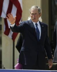 George W. Bush waves to guests following the dedication of the George W. Bush Presidential Center Thursday in Dallas.