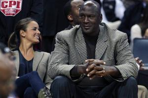 Charlotte Bobcats owner Michael Jordan sits with Yvette Prieto at a game last year.