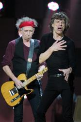 In this Dec. 12, 2012 file photo, Rolling Stones Keith Richards and Mick Jagger perform on stage at the 12-12-12 The Concert for Sandy Relief.