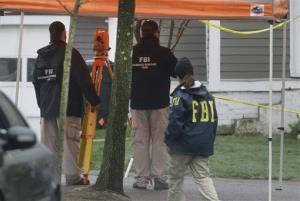 FBI agents continue to investigate the scene in Watertown, Mass., Tuesday, April 23, 2013 where Boston Marathon bombing suspect Dzhokhar Tsarnaev was captured.