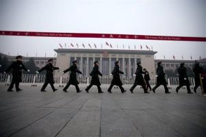 Chinese soldiers march outside the Great Hall of the People before the closing ceremony of the National People's Congress in Beijing, China, Sunday, March 17, 2013.