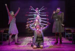 This theater publicity image released by Boneau/Bryan-Brown shows the cast of Matilda The Musical, including Bertie Carvel, right, and Lauren Ward, left, during a performance in New York.