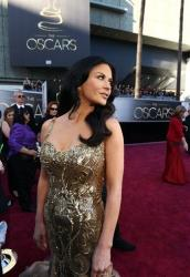 Actress Catherine Zeta-Jones arrives at the Oscars at the Dolby Theatre on Sunday, Feb. 24, 2013, in Los Angeles.