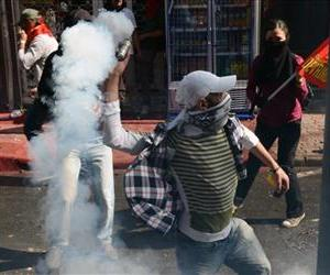 Clashes erupt between police and protesters during May Day celebrations in Istanbul, Turkey, Wednesday May 1, 2013.