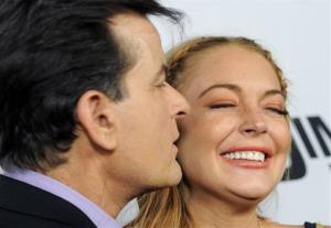 Lindsay Lohan, a cast member in Scary Movie V, gets a kiss from fellow cast member Charlie Sheen at the Los Angeles premiere of the film at the Cinerama Dome on April 11, 2013 in Los Angeles.