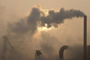Smoke pours out of chimneys at a cement plant in Binzhou city, in eastern China's Shandong province, earlier this year.