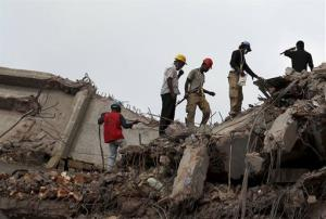Workers and army personnel toil in the collapsed garment factory building in search for bodies on Thursday, May 2, 2013. Rescuers found more bodies in the concrete debris of a collapsed garment factory building Thursday and authorities say it may take another five days to clear the rubble. In addition...