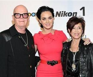 Katy Perry poses with her parents Keith and Mary Perry at Billboard's Women in Music 2012 luncheon at Capitale on Friday Nov. 30, 2012 in New York.