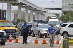 Airport security members divert traffic around the Marriott before getting to Terminal B at Bush Intercontinental Airport on Thursday, May 2, 2013 in Houston.