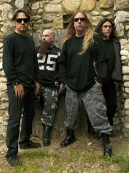 This 2009 publicity photo provided courtesy of Slayer shows, from left, Dave Lombardo, Kerry King, Jeff Hanneman and Tom Araya.