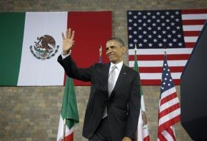President Obama waves after speaking at the Anthropology Museum in Mexico City Friday.