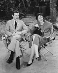 Watching the filming of a scene for the 1962 movie To Kill a Mockingbird are producer Alan Pakula and author Harper Lee.