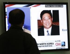 A South Korean man watches a television news program showing Korean American Kenneth Bae in Seoul, South Korea, Thursday, May 2, 2013.